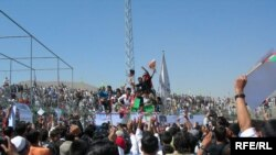 Nekpa (center, in white) is swallowed up by the crowd at Ghazi Stadium (click to enlarge)