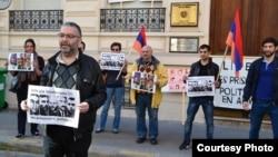 France - French-Armenian activist Schanth Vosgueritchian (L) leads a protest outside the Armenian Embassy in Paris, 28April 2015.