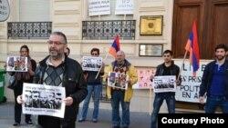 France - French-Armenian activist Schanth Vosgueritchian leads a protest outside the Armenian Embass in Paris, 28April 2015.