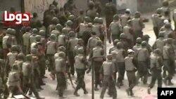 Дума қаласының маңындағы сириялық үкімет әскері. Сәуір, 2012 жыл. Көрнекі сурет