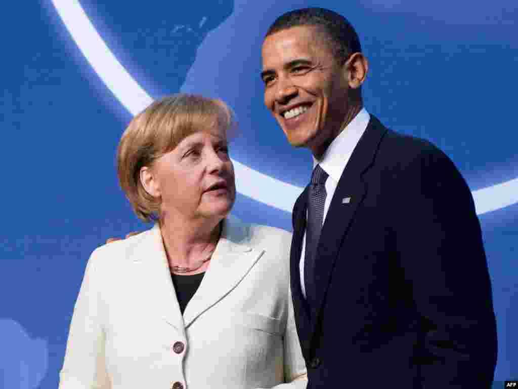 Прэзыдэнт ЗША Барак Абама з канцлеркай Нямеччыны Ангелай Мэркель, якая прыбыла ў Вашынгтон, каб ўзяць удзел у канфэрэнцыі па ядзернай бясьпецы.
