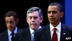 U.S. President Barack Obama (right), British Prime Minister Gordon Brown (center), and French President Nicolas Sarkozy gather to condemn Iran after Tehran revealed it is secretly building a second uranium-enrichment facility.