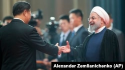 حسن روحانی، رئیسجمهوری ایران، در یکی از دیدارهایش با شی ژیپینگ، همتای چینیاش