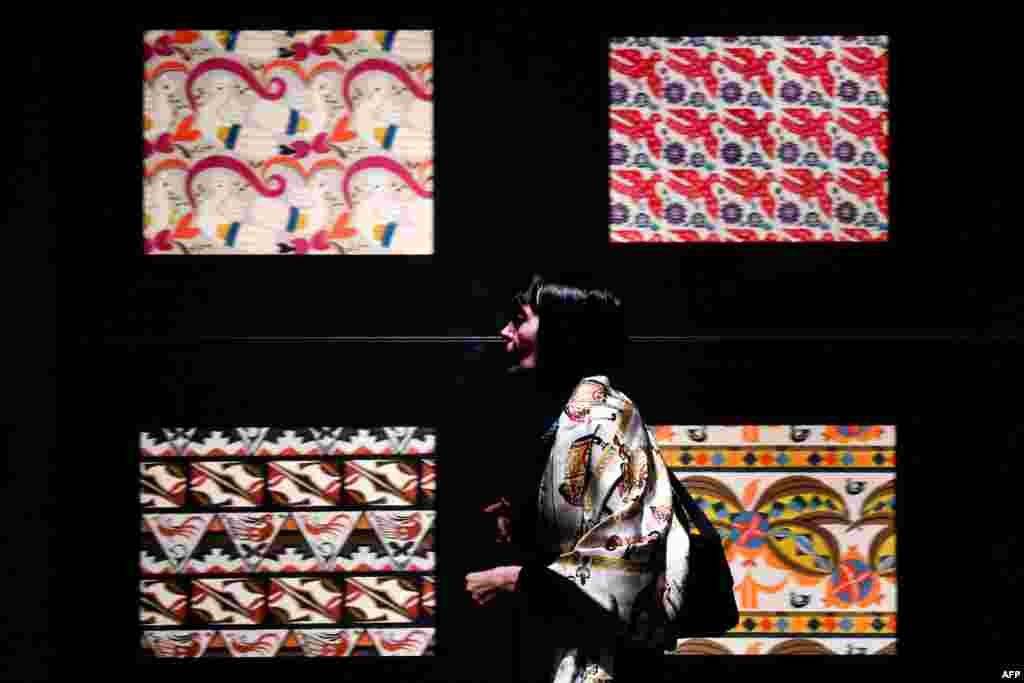 A visitor examines a display at an exhibition dedicated to the 150th anniversary of Russian theatrical designer Leon Bakst's birth at the Pushkin Museum of Fine Arts in Moscow. (AFP/Kirill Kudryavtsev)