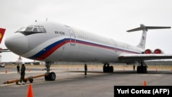 A Russian Ilyushin Il-62M Air Force plane, one of the two Russian military planes that arrived with troops and equipment to Venezuela the previous weekend, sits on the tamrac at Simon Bolivar International Airport in Maiquetia, on March 29.