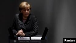 Анґела Меркель виступає у Бундестазі, Берлін, 13 березня 2014 року