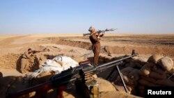 """Бойцы курдского отряда """"пешмерга"""" в окрестностях Эрбиля. 10 сентября 2014 года."""