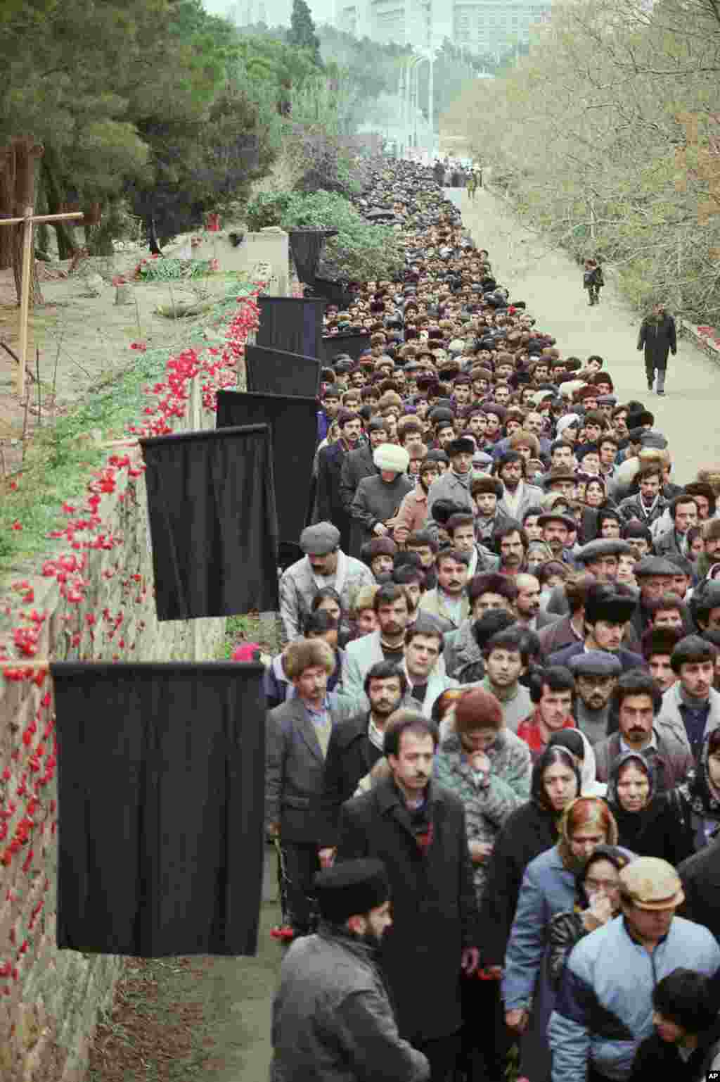 Thousands of mourners walk past graves dug in a Baku park on February 3, 1990. Twenty months later, on October 18, 1991, Azerbaijan declared independence.