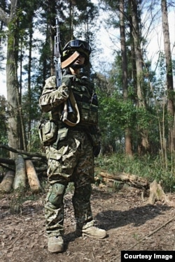 A Japanese cosplayer dressed as a Ukrainian soldier.