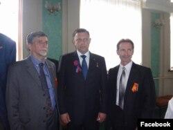 Слева направо: Палмарино Дзокателли, Александр Захарченко, Элизео Бертолаззи