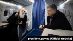 Патриарх Филарет и Пётр Порошенко, 28 декабря 2018 года