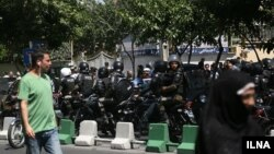 Security guards on the streets around the Iranian parliament in Tehran on June 7.