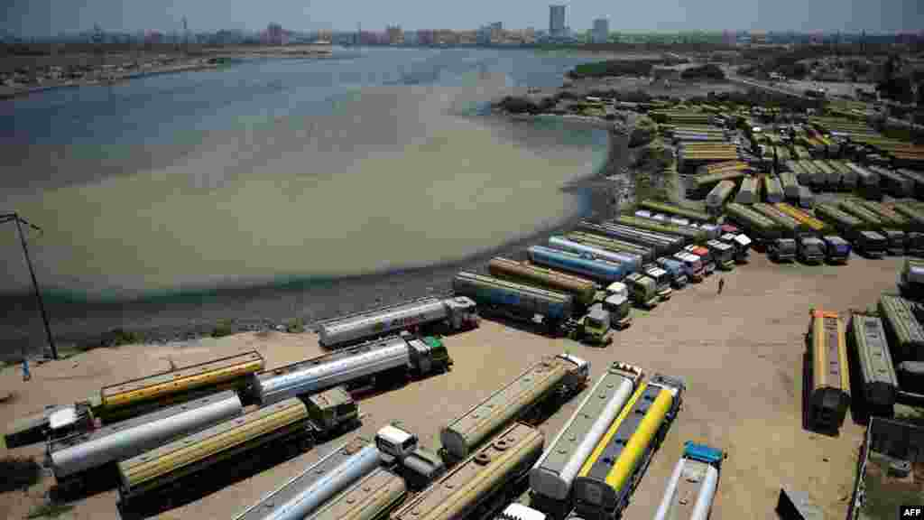 Tanker trucks, used to transport fuel to NATO forces in Afghanistan, are seen parked near oil terminals in the Pakistani port city of Karachi. (AFP/Asif Hassan)