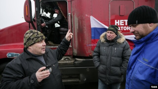 Dozens of long-distance truckers set up protest camps on the outskirts of Moscow to protest a new Kremlin-sanctioned road-levy, which they say amounts to highway robbery.