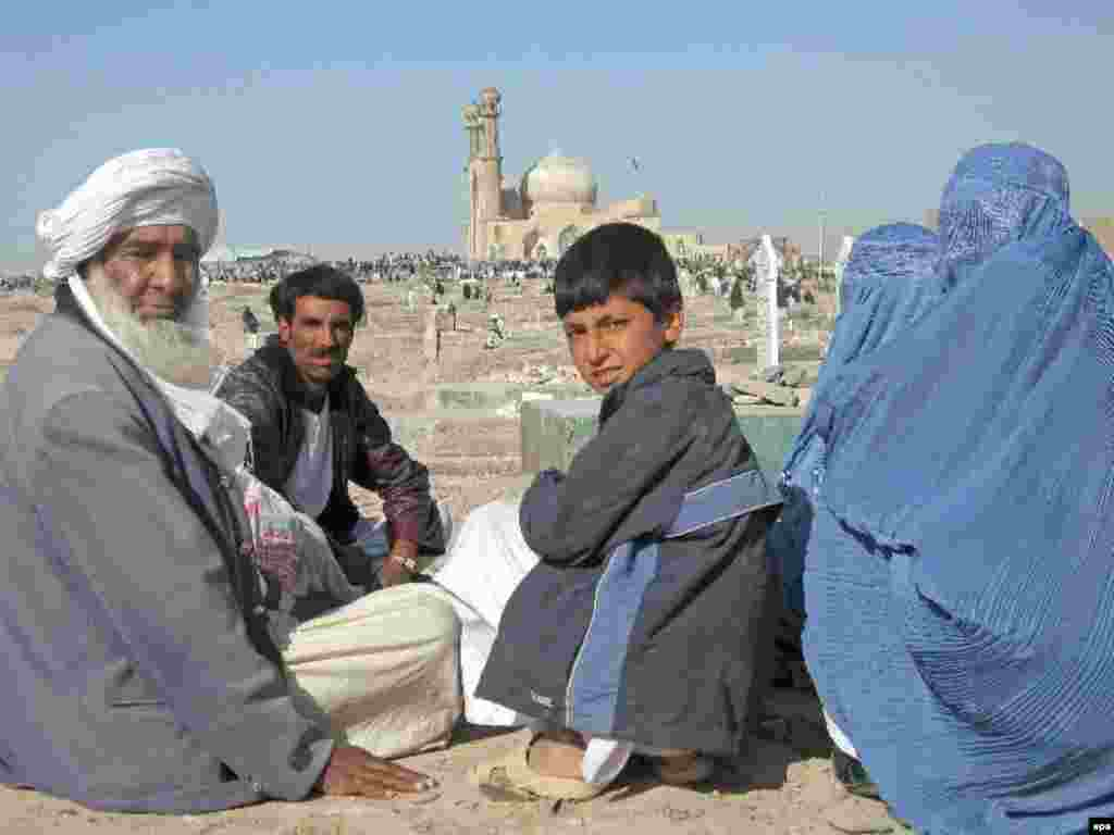 An Afghan family visits the graves of their relatives at the shrine of Sultan Aqa in Herat - Noruz08 Caption: epa01292003 An Afghan family visit graves of their relatives as they celebrate the Persian New Year Noruz, at the Shrine of Sultan Aqa in Herat, western Afghanistan 20 March 2008 Noruz08