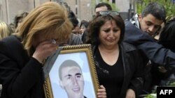 Relatives of a protester killed in the postelection violence lay flowers in his memory in Yerevan in April 2008