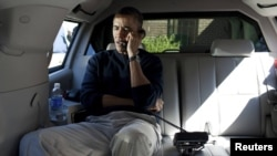 U.S. President Barack Obama speaks on the telephone with Afghan President Hamid Karzai to convey his shock over the shootings.
