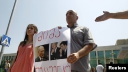 Journalists protest outside the Interior Ministry office in Tbilisi on July 7 following the arrests.