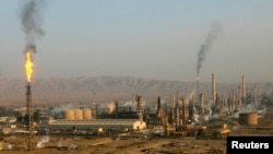 The Iraqi Army reported a critical victory against IS militants in Baiji, home to the country's largest oil refinery (above). The fate of the refinery remains unclear, however.