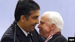 President Mikheil Saakashvili (left) greets Senator McCain in Batumi