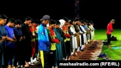 Players offering prayer in a cricket stadium that was later bit by blasts.