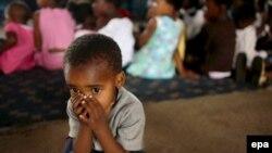 Больной СПИДом ребенок в приюте Йоханнесбурга, ЮАР