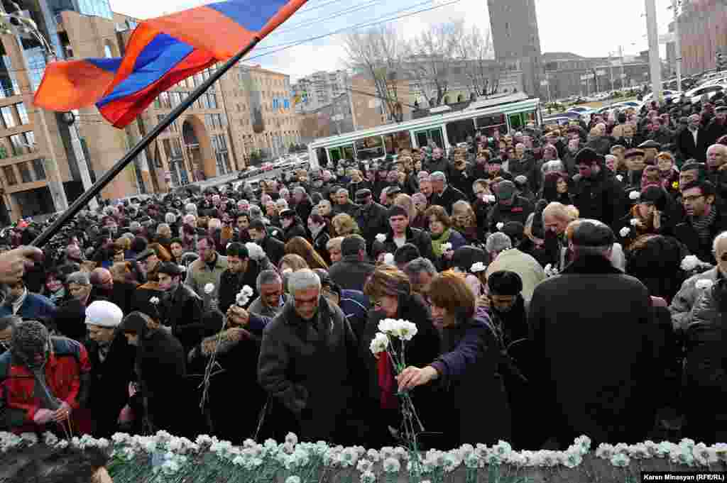 On March 1, Armenian opposition supporters pay an anniversary tribute to those who died in post-election violence five years previously.On March 1, 2008, demonstrators protesting the official presidential election results were violently dispersed by security forces, leaving 10 people dead. (RFE/RL/Karen Minasyan)