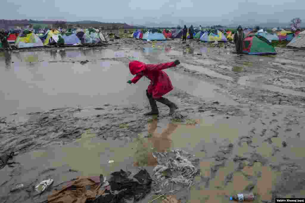 A girl walks through the mud at a refugee and migrant camp near Idomeni, Greece, close to the border with Macedonia, on March 10. (epa/Valdrin Zhemaj)