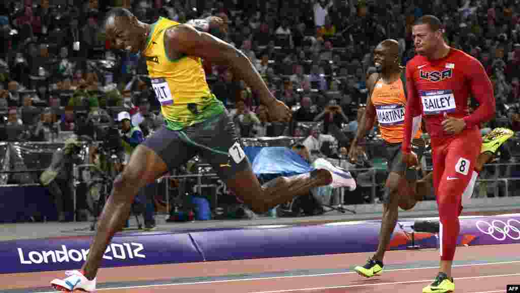 "Jamaica's Usain Bolt (left) wins the men's 100-meter final at the Olympic Games on August 5. Bolt thus became the first male sprinter to achieve a ""double double"" by winning both the 100-meter and 200-meter titles at consecutive Olympics. (AFP/Adrian Dennis)"