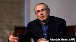 Exiled former Russian oligarch Mikhail Khodorkovsky speaks to the Associated Press during an interview in London on February 15.