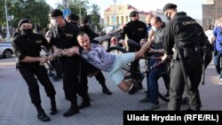 Police detain a protester at a rally in Minsk on June 19.
