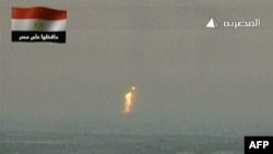 An image grab taken from Egyptian state television shows what the channel said is a flame rising from the site of an attack on a gas pipeline. (AFP Photo/Al-Masriya TV)