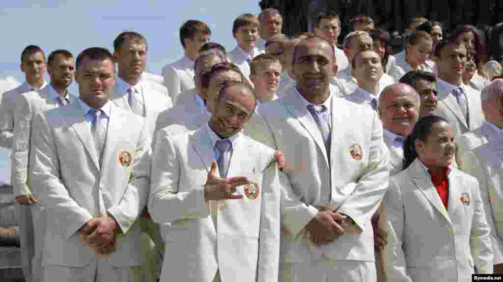 The Belarusian Olympic delegation poses in sleek white suits in Victory Square in Minsk before their departure for London.