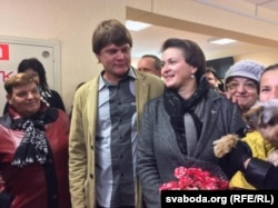 Tatsyana Karatkevich and her husband at a polling station in Minsk on October 11, 2015