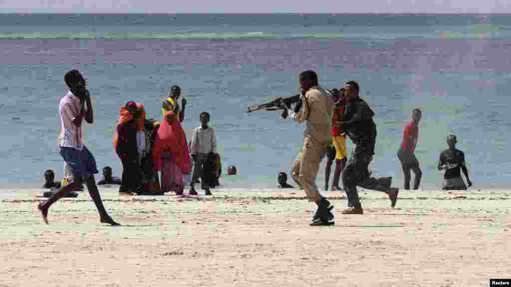 Somali police arrest a suspected member of the Al-Qaeda-affiliated Al-Shabaab group on Lido Beach on March 23. (Reuters/Feisal Omar)