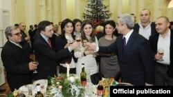 Armenia - President Serzh Sarkisian congratulates journalists at a New Year's reception, 29Dec2011.
