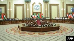 Senior parliamentary members from Iraq and neighboring countries meet on April 19 in Baghdad.
