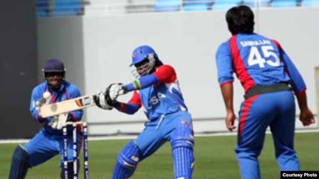 A U.S. batsman takes a swing in a qualifier against Afghanistan, won by the Afghans, in Dubai on February 11 for the Twenty20 World Cup. (photo International Cricket Council)