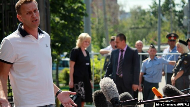 Russian opposition blogger Aleksei Navalny talks to reporters before meeting with police investigators on July 31.