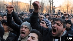 Armenian protesters shout slogans in front of the prosecutor's office in Gyumri.