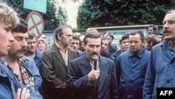 Poland, 1980 - Lech Walesa (center) addresses striking workers; 10 years on, he would be elected president