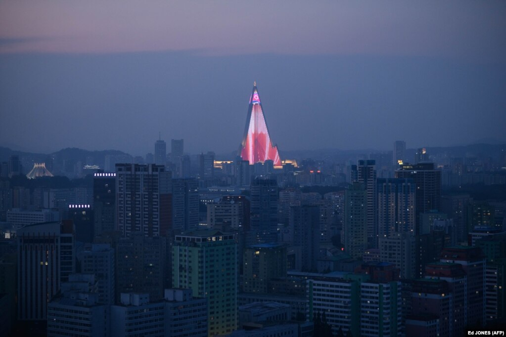A light show is displayed on the Ryugyong hotel amid the city skyline of Pyongyang. North Korea is preparing to mark the 70th anniversary of its founding on September 9. (AFP/Ed Jones)