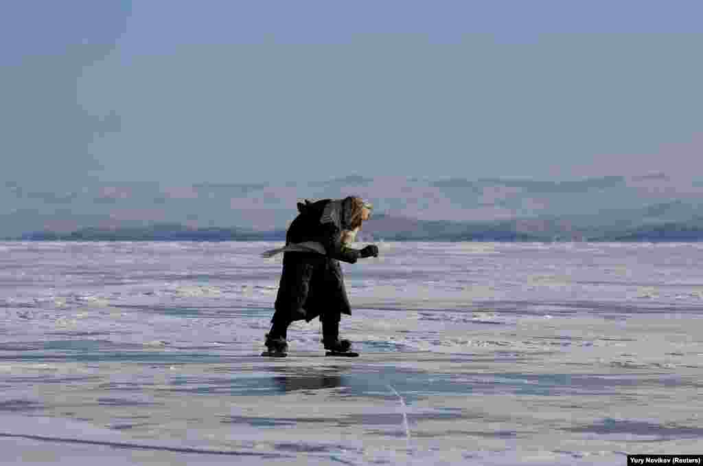Lyubov Morekhodova, 79, skates on ice-covered Lake Baikal in Russia's Irkutsk region. (Reuters/Yury Novikov)