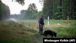 A Lithuanian border guard patrols on the frontier with Belarus, some 160 kilometers from the capital, Vilnius.