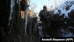 A Ukrainian soldier patrols along the front line with separatist forces in the east of the country.