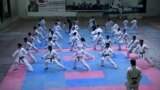 Bosnia and Herzegovina, Hazara minority women defy extremism with karate, video grab. AP