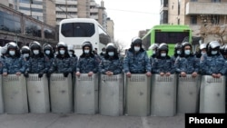 Armenia -- Riot police are seen outside the Armenian parliament building in Yerevan during opposition protests, March 10, 2021.