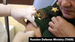Russian Defense Minister Sergei Shoigu receiving the Sputnik V coronavirus vaccine in Moscow on September 4.
