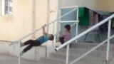Turkmenistan. Children playing outside. Split systems on the building. Ashgabat. March 2021
