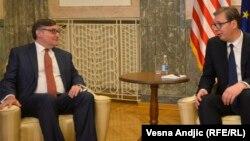 U.S. Deputy Assistant Secretary of State Matthew Palmer (left) and Serbian President Aleksandar Vucic in Belgrade on June 3.